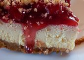 picture of crust  - Cheesecake with graham cracker crust and cherries up close - JPG