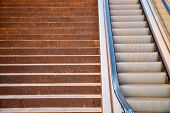 picture of escalator  - Full frame take of a staircase next to an escalator