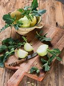 picture of kohlrabi  - Fresh raw kohlrabi vegetables with the leaves on a rustic wooden background - JPG