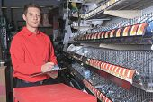 picture of hardware  - A employee of a hardware store at work - JPG
