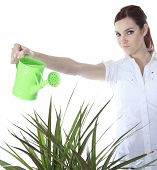 stock photo of pinafore  - Beautiful Happy Woman Holding Watering Can. Isolated On White