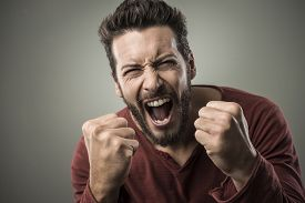 stock photo of shout  - Angry aggressive man shouting out loud with ferocious expression - JPG