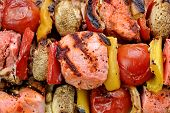 picture of braai  - BBQ Grilled Mixed With Vegetables Pork Kebabs On The Wooden Cutting Board - JPG