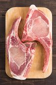 stock photo of pork belly  - Fresh pork chops or cutlets on wooden background - JPG
