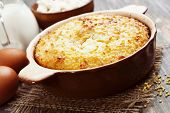 image of millet  - Casserole with millet and curd on the wooden table - JPG