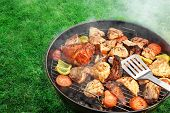 foto of flipper  - Spatula BBQ Assorted Meat And Vegetables On The Hot Flaming Grill - JPG