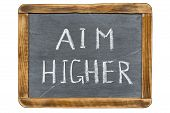 picture of slogan  - aim higher slogan handwritten on vintage slate chalkboard isolated on white - JPG