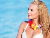 picture of hawaiian flower  - Portrait of cute blond female wearing beautiful Hawaiian leis - JPG