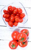 pic of plum tomato  - tomatoes in a glass jar on a white table - JPG