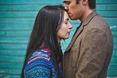 picture of amor  - Amorous man kissing young woman on forehead - JPG