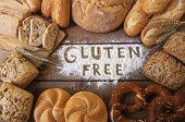 foto of carbohydrate  - A gluten free breads on wood background - JPG