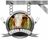 image of food chain  - Metallic sign with head of cow forks and metallic ribbon with text Steak house - JPG
