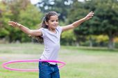 image of hula hoop  - happy girl playing with hula hoops on a sunny day - JPG
