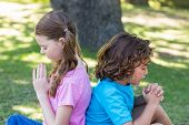 foto of pentecostal  - Little siblings making funny faces at camera on a sunny day - JPG