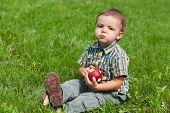 Little Boy Eating Apple Outside