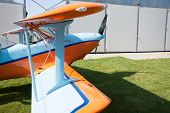 stock photo of biplane  - light aircraft modern biplane orange and blue details and takeoff