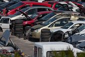 stock photo of scrap-iron  - Many old cars at the scrap yard - JPG