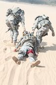 pic of medevac  - United States paratroopers airborne infantrymen in the desert rescuing their brother - JPG