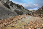 image of ashes  - Creek in the gorge between the mountains of black volcanic ash - JPG