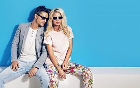 picture of blue  - Young fashionable couple on blue background - JPG