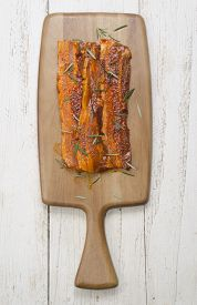 stock photo of pork belly  - paprika marinated pork belly with rosemary on wooden board - JPG