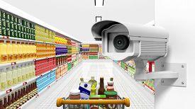 stock photo of shoplifting  - Security surveillance camera with supermarket interior as background - JPG