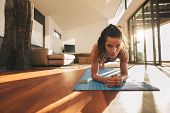 Fit Young Woman Doing Push Ups At Home poster
