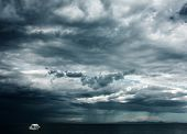 picture of flood-lights  - Alone white little boat in sea with storm weather - JPG