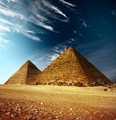 stock photo of the great pyramids  - Giza valley with Great pyramids and blue sky with clouds - JPG