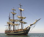 picture of pirate ship  - Pirate style ship setting sail on the high seas - JPG