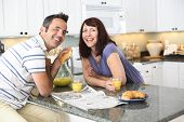 stock photo of married couple  - Couple together in kitchen - JPG