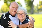 stock photo of senior adult  - Portrait of senior couple outdoors - JPG
