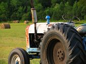 stock photo of workhorses  - Old tractor - JPG