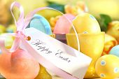 foto of happy easter  - Festive decorations and eggs with card that reads Happy Easter - JPG