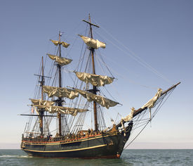 pic of pirate ship  - Pirate style ship setting sail on the high seas - JPG