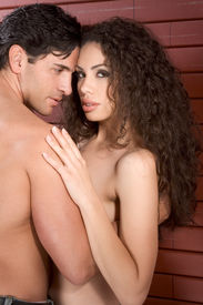 foto of early 20s  - Loving affectionate nude heterosexual couple in affectionate sensual kiss - JPG