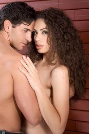 stock photo of lewd  - Loving affectionate nude heterosexual couple in affectionate sensual kiss - JPG
