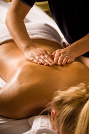 image of spa massage  - woman at a day spa getting a relaxation massage - JPG