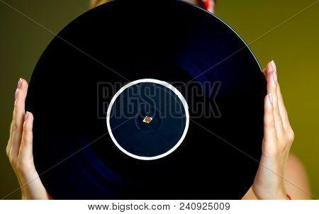 Retro woman with music vinyl