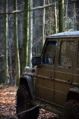 Dirty Offroad Car With Fall Forest On Background On Sunny Autumn Day, Defocused. Suv Covered With Mu poster