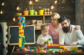 Family Leisure Concept. Parents Hugs, Watching Son Playing, Enjoy Parenthood. Kid With Parents Play  poster