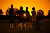 Sunset Soccer. Kids Soccer Football Team On Training With The Coach. Sports Soccer Practice At Sunse poster
