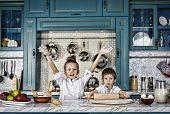 Happy Family Funny Kids Are Preparing The Dough, Bake Cookies In The Kitchen. Casual Still Life Phot poster
