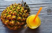 Glass Of Fresh Pineapple Juice And Ripe Pineapple Fruit On Rustic Wooden Table.freshly Squeezed Pine poster