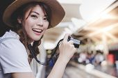 Portrait Enjoying Life Of Beautiful Traveler Woman. Charming Beautiful Girl Is Taking Tourist Locati poster