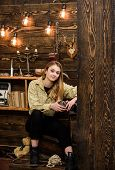Lady Enjoy Hot Drink In Metallic Mug In Warm Atmosphere, Wooden Interior. Girl On Relaxed Face In Pl poster