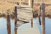Broken Wooden Bridge. Water Overflow On A Broken Wooden Bridge poster