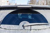 Car Wiper On Dirty Rear Window Of Modern Suv Car poster