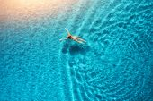 Aerial View Of Swimming Woman In Mediterranean Sea At Sunset poster