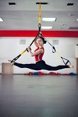 Fit Pretty Young Woman Doing Fly Yoga Stretching Exercises With Trx Fitness Straps In Fitness Traini poster